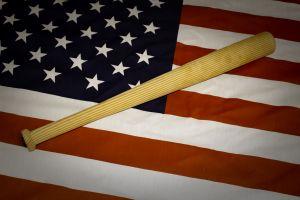 American flag and baseball bat